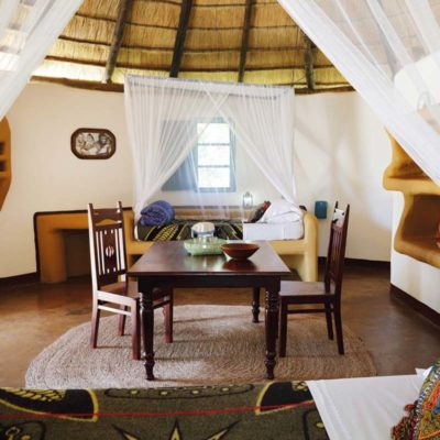 6Planet Baobab - Bakalanga Hut beds and dining table detail