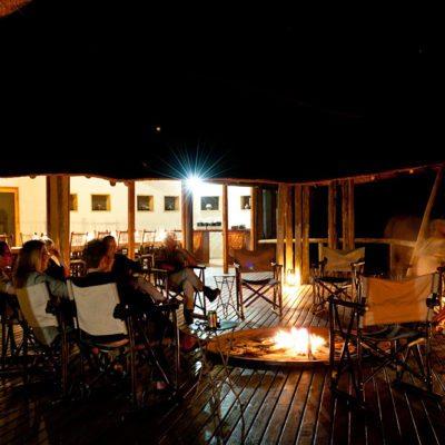 Kwando Tau Pan evening camp fire