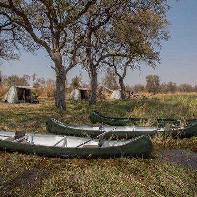 canoe trail, canoes and camp